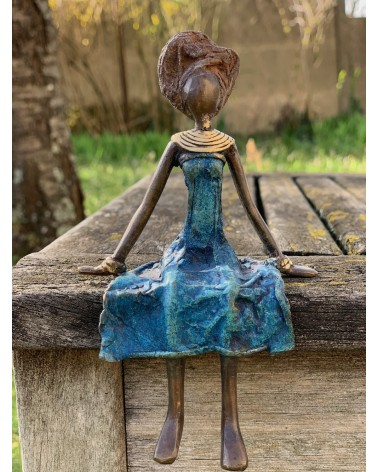 Bronze statue woman in blue