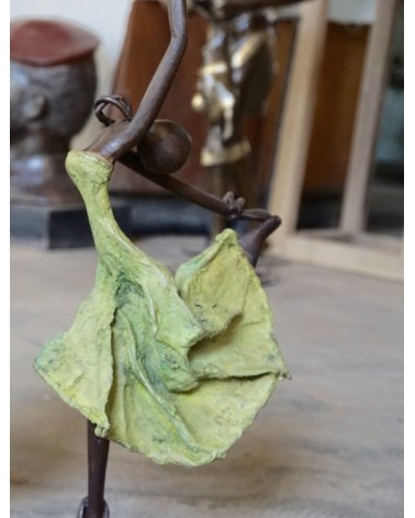 Bronze statue of dancer in green